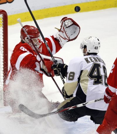 Detroit Red Wings goaltender Chris Osgood makes the save on the Pittsburgh Penguins' Tyler Kennedy.  (Associated Press / The Spokesman-Review)