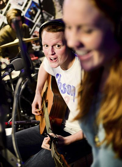 FILE - In this Dec. 3, 2012 file photo, Zach Sobiech, left, plays guitar as his friend Samantha