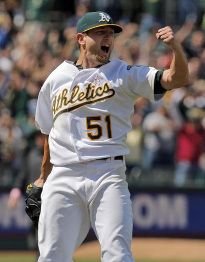 Oakland Athletics starting pitcher Dallas Braden celebrates throwing a perfect game against the Tampa Bay Rays during a baseball game in Oakland, Calif., May 9, 2010. (Carlos Avila Gonzalez / San Francisco Chronicle via AP)