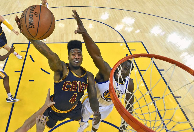 Cleveland Cavaliers guard Iman Shumpert (4) shoots against Golden State Warriors forward Draymond Green during the first half of Game 2 of basketball's NBA Finals in Oakland, Calif., Sunday, June 7, 2015. (Kyle Terada/USA TODAY Sports Pool via AP) ORG XMIT: OAS132