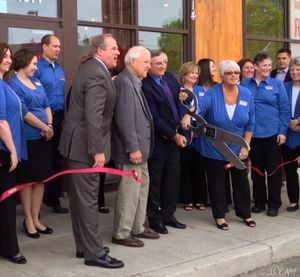 AAA Washington President and CEO, Kirk Nelson, board member, Greg Bever, and others formally open the new AAA travel store in Spokane