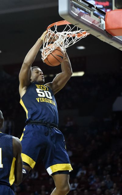 West Virginia's Sagaba Konate dunks the ball in the first half of an NCAA college basketball game against Oklahoma in Norman, Okla., Monday, Feb. 5, 2018. (Kyle Phillips / Associated Press)