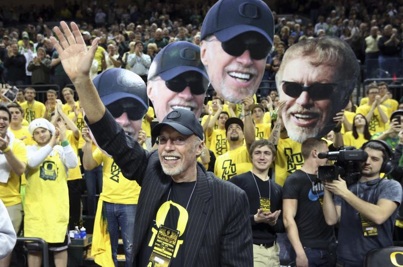 In this  2014 file photo, Nike's Phil Knight acknowledges the crowd on Uncle Phil Appreciation Night at Matthew Knight Arena during Oregon's NCAA college basketball game against Southern California in Eugene. (Chris Pietsch / Associated Press)