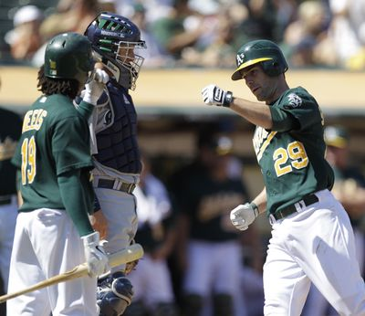 Oakland's Scott Sizemore, right, celebrates with teammate Jemile Weeks, left, after hitting a fifth-inning homer. (Associated Press)