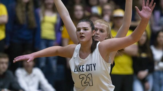 Lake City's Brooklyn Rewers posts up against Coeur d'Alene on Feb. 12. Rewers, the reigning Inland Empire League co-MVP, is closing in on 1,000 career points and has committed to Michigan State.  (Cheryl Nichols)