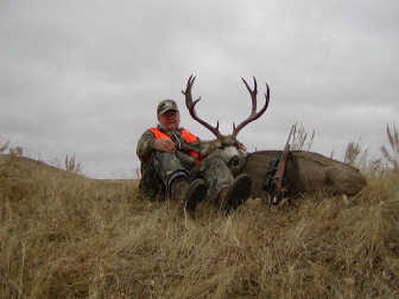 Frank Moran poses with the deer he killed while hunting in Eastern Montana.  (Associated Press / The Spokesman-Review)