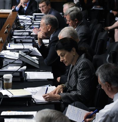 The Senate Finance Committee, including Sen. Olympia Snowe, R-Maine, listen during opening remarks of the markup of health care legislation Tuesday on Capitol Hill in Washington.  (Associated Press / The Spokesman-Review)