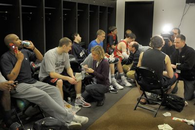 Gonzaga players meet with members of the press for locker-room interviews in the Rose Garden on Friday.  (Christopher Anderson / The Spokesman-Review)