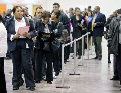 Applicants line up for the opening of the job fair held by Hartsfield Jackson Airport in Atlanta in March 27, 2018. (Associated Press)