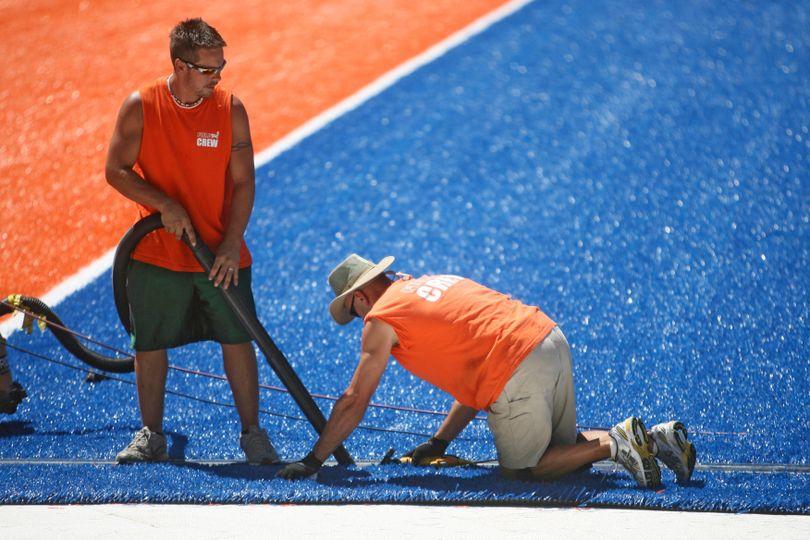 This photo taken Monday July 12, 2010 shows FieldTurf working to install the new blue turf at Bronco Stadium. (AP Photo/Idaho Statesman, Shawn Raecke) (Shawn Raecke / AP)
