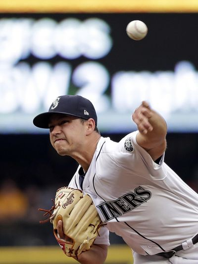 Seattle Mariners starting pitcher Marco Gonzales throw to a Los Angeles Angels batter during the first inning Saturday in Seattle. (Elaine Thompson / AP)