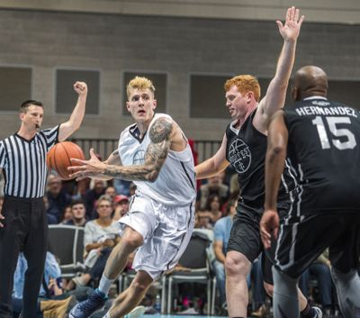 Micah Downs is fouled by David Pendergraft in the first half of the Gonzaga Alumni Game in 2016. Downs, 34, is in Seattle taking part in the Crawsover this summer.  (DAN PELLE)