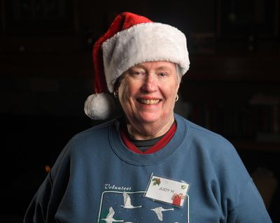 Judy Hudson used to volunteer a lot of her time at the Christmas Bureau, but now that she's getting older she can't do as much. But she still shows up at lunchtime and fills in for other volunteers so they can go have lunch. (Dan Pelle / The Spokesman-Review)