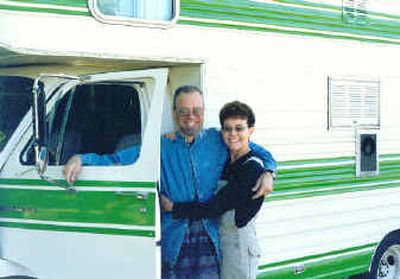 Ken Yuhasz and Patt Earley have racked up a lot of miles on the 1976 Brougham motorhome they bought in 2000.  (Julianne Crane photo / The Spokesman-Review)