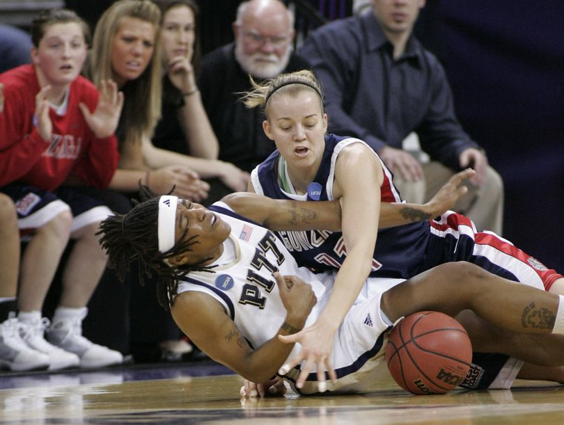 ORG XMIT: WAJF101 Pittsburgh's Shavonte Zellous, left, and Gonzaga's Janelle Bekkering vie for a loose ball during the first half in Seattle on Monday, March 23, 2009, in a second-round women's NCAA college basketball tournament game. (AP Photo/John Froschauer) (John Froschauer / The Spokesman-Review)