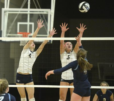 Maddie Lee (5) goes up to block Gonzaga Prep's Kate Budig during a Greater Spokane League volleyball match Oct. 13, 2015. (Jesse Tinsley / The Spokesman-Review)