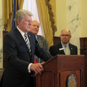 Gov. Butch Otter speaks at a press conference on Thursday, March 29, 2018; at right are House Majority Leader Mike Moyle and Senate Majority Leader Chuck Winder. (The Spokesman-Review / Betsy Z. Russell)