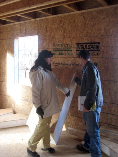 Homeowner Anjali Hansen consults with Charles Byrd, chief executive of IntelliStructures, which is installing special insulation in her 4,000-square-foot house in Falls Church, Va. Washington Post (Washington Post / The Spokesman-Review)