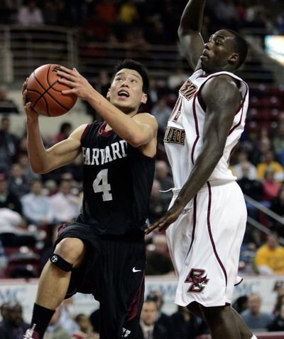 Harvard's Jeremy Lin drives past B.C.'s Rakim Sanders on Wednesday.  (Associated Press / The Spokesman-Review)