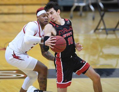 Eastern Washington guard Jacob Davison, who scored 31 points, works against Southern Utah guard John Knight III.  (Tyler Tjomsland/THE SPOKESMAN-RE)