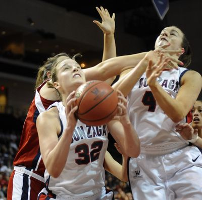 Kayla Standish of Gonzaga grabs an offensive rebound as her teammate Kelly Bowen takes a shot to the face during their game in the WCC Championship Tournament in Las Vegas on Saturday. Gonzaga pulled out a tight game to win in the final minutes and advance to the Monday Championship game.   (Christopher Anderson)