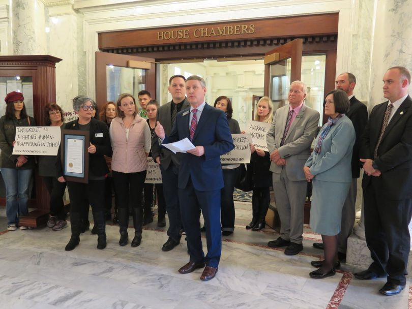 Rep. Brent Crane, R-Nampa, joins advocates against human trafficking, and a handful of other lawmakers, at a Statehouse news conference to announce planned legislation. (Betsy Russell)