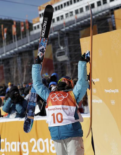 Gold medal winner Sarah Hoefflin, of Switzerland, reacts to her score during the women's slopestyle finals at Phoenix Snow Park at the 2018 Winter Olympics in Pyeongchang, South Korea, Saturday, Feb. 17, 2018. (Gregory Bull / Associated Press)