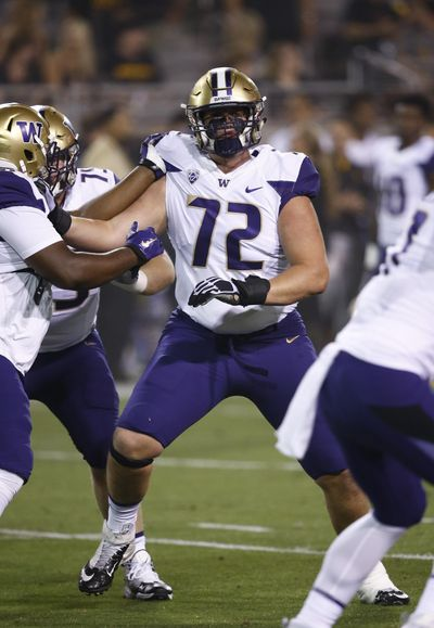 Washington offensive lineman Trey Adams (72) makes a block during warmup drills prior to an NCAA college football game against Arizona State, Saturday, Oct. 14, 2017, in Tempe, Ariz. Arizona State defeated Washington 13-7. (AP Photo/Ross D. Franklin) (Ross D. Franklin / AP)