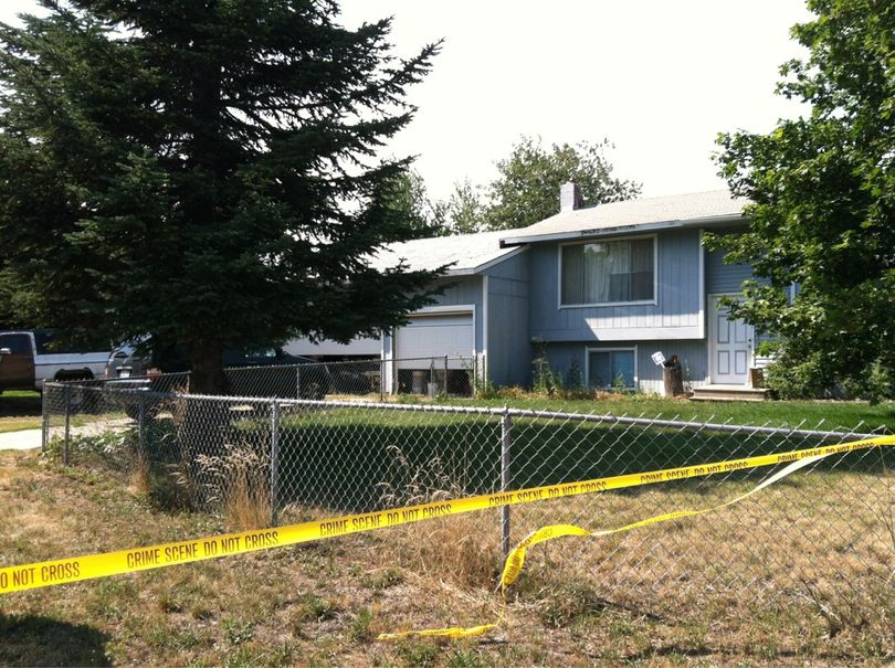 Detectives search murder suspect Daniel Arteaga's home at 19329 E. Valleyway Ave., in Spokane Valley on Tuesday. (Meghann Cuniff / The Spokesman-Review)