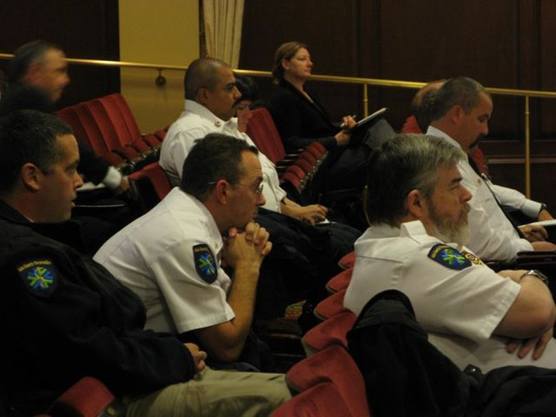 Emergency medical services providers are among those listening in the audience as the Idaho Legislature's joint legislative oversight committee hears a newly unveiled report calling for reforms in how Idaho organizes and provides its emergency medical services across the state. (Betsy Russell)