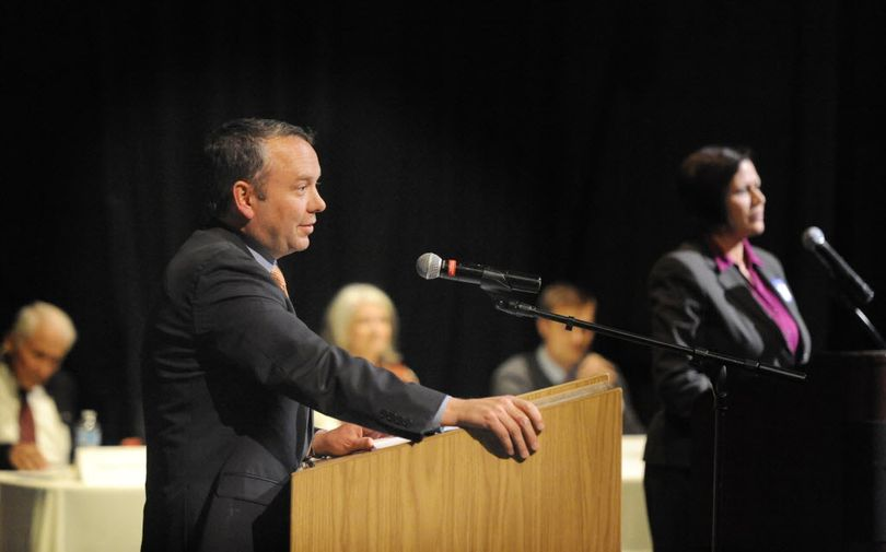 Spokane Mayor David Condon, left, and his opponent, Shar Lichty, right, at the candidate debates held by the Chase Youth Commission Wednesday, Oct. 7, 2015 at North Central High School. (Jesse Tinsley / The Spokesman-Review)