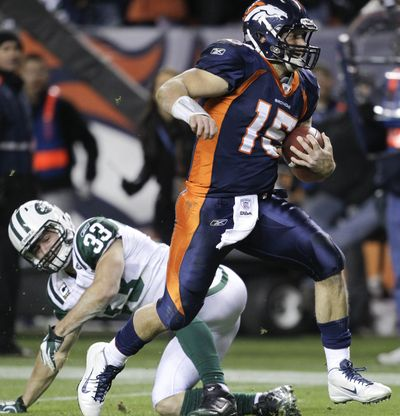 Denver Broncos quarterback Tim Tebow gets by New York Jets free safety Eric Smith on his way to a winning touchdown in the fourth quarter Thursday night. (Associated Press)