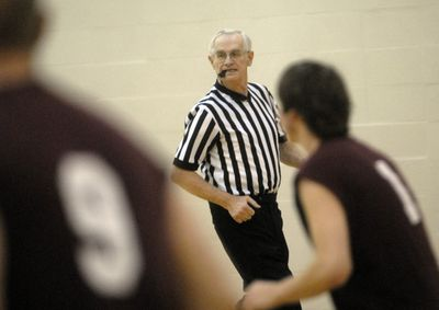 Gary Broadbent keeps a watchful eye over the Spokane County D League tournament game between Players & Spectators and Koohms Home Painting. The 69-year old  has been officiating basketball, baseball, softball and volleyball games for 50 years.  (J. BART RAYNIAK / The Spokesman-Review)