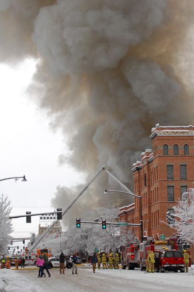 Emergency personnel respond to an explosion on Main Street in Bozeman on Thursday.  (Associated Press / The Spokesman-Review)