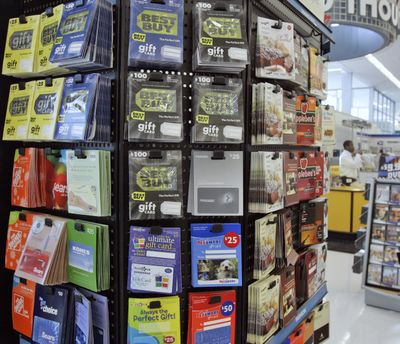 Consumers would be wise to read the fine print before purchasing any gift card. (Associated Press / The Spokesman-Review)