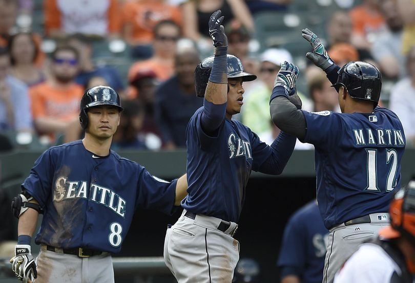 Seattle Mariners, Ketel Marte, center, congratulates Leonys Martin, right, on a two run home run, which Marte score on, against the Baltimore Orioles in the ninth inning of a baseball game, Thursday, May 19, 2016, in Baltimore. Also pictured at left is Norichika Aoki. (Gail Burton / Associated Press)