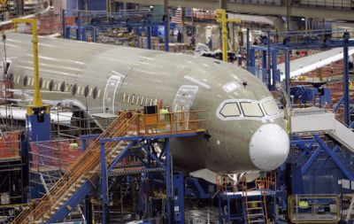 One of the first Boeing 787 jets is seen on the assembly line nearly surrounded by scaffolding during a media tour in Everett. (File Associated Press / The Spokesman-Review)