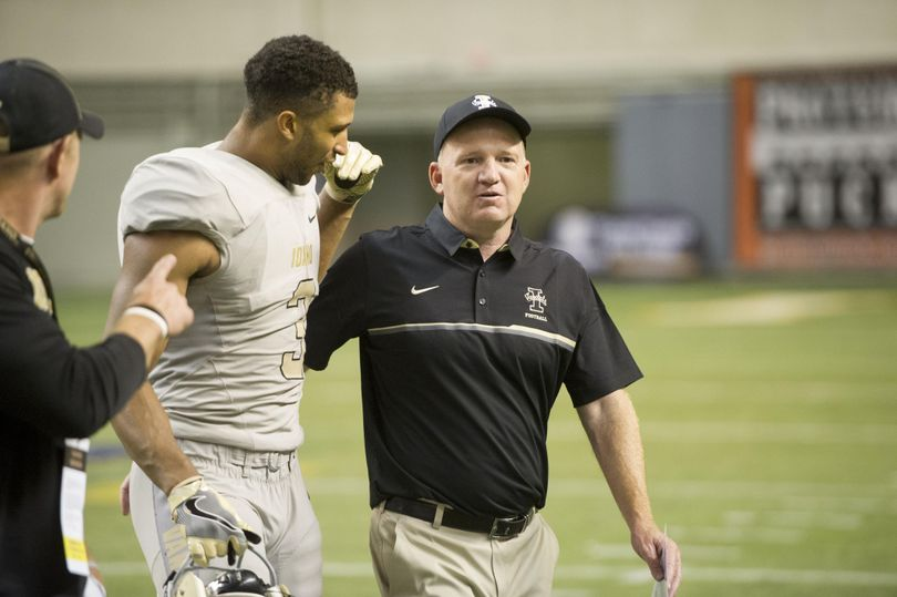 Idaho tight end Deon Watson (3) gets a pat on the back from head coach Paul Patrino as the clock runs down against Montana State during a college football game on Thursday, Sep 1, 2016, outside the Kibbie Dome in Moscow, ID. Idaho won the game 20-17. (Tyler Tjomsland / The Spokesman-Review)
