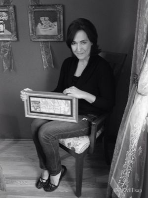 Susanna Baylon holds the framed invitation that brought marriage and a family. (Cheryl-Anne Millsap / Photo by Cheryl-Anne Millsap)