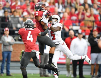 Washington State cornerback Darrien Molton (3) intercepts a pass intended for Eastern Washington  wide receiver Nsimba Webster (5) during the first half  Saturday  at Martin Stadium in Pullman. (Tyler Tjomsland / The Spokesman-Review)