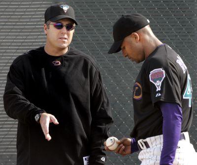 Bryan Price, left, didn't like Arizona's direction.  (Associated Press / The Spokesman-Review)