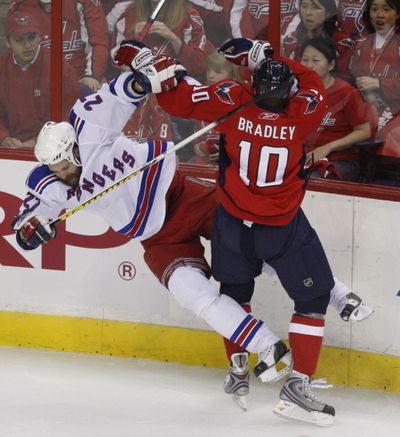 Rangers defenseman Paul Mara collides with Washington's Matt Bradley.  (Associated Press / The Spokesman-Review)