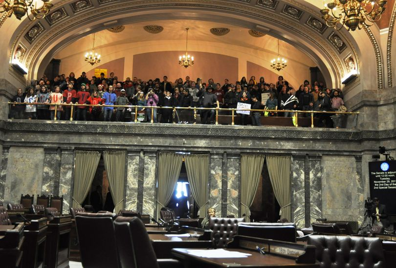 Sen Karen Fraser, D-Olympia, is the only senator in the chamber as Occupy protesters chant from the gallery. (Jim Camden)
