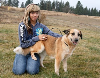 Ericka Evans is a Pawsitive Works volunteer. The dog with Ericka is Toven.