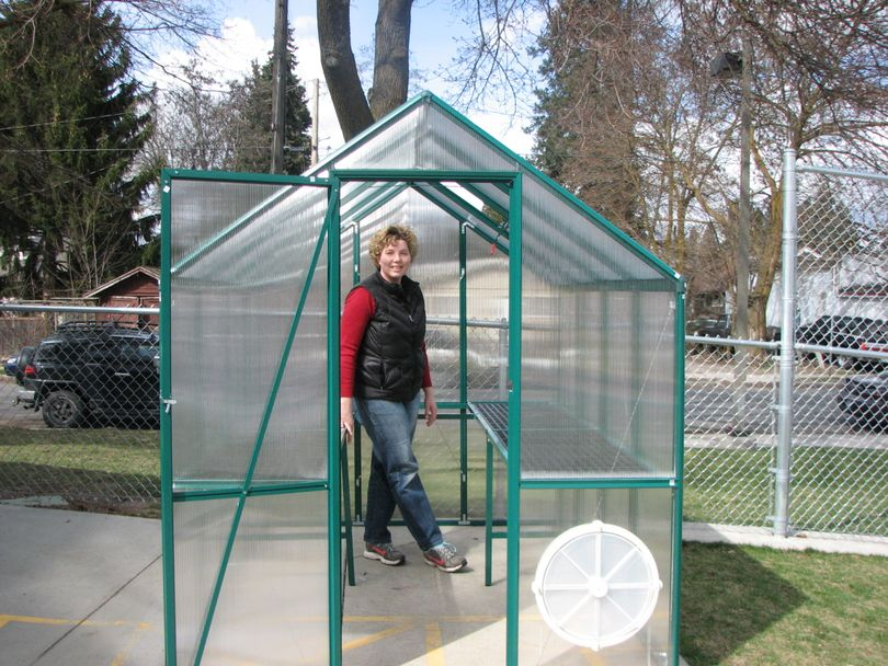 Heidi Hash, parent volunteer at Grant Elementary School, stands in the greenhouse the school just won from the Washington State Potato Commission and Yokes Fresh Markets. The school will start a garden club this spring. (Pia Hallenberg)
