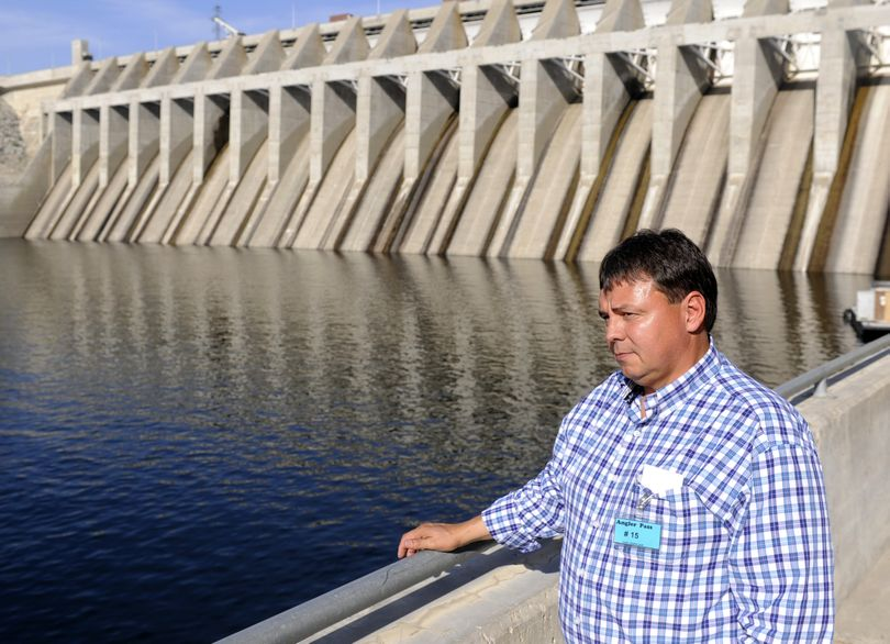 Joe Peone, former fisheries manager for the Confederated Tribes of the Colville Reservation, stands at Chief Joseph Dam on the Columbia River. The tribal government was a key advocate for a hatchery below the dam to provide more fish for  the tribe, but which will benefit other anglers as well. (Jesse Tinsley / The Spokesman-Review)