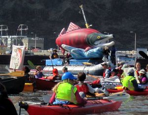 A flotilla of paddlers stage in front of Lower Granite Dam in a peaceful protest to promote removing the four lower Snake River dams. (Bart Rayniak)