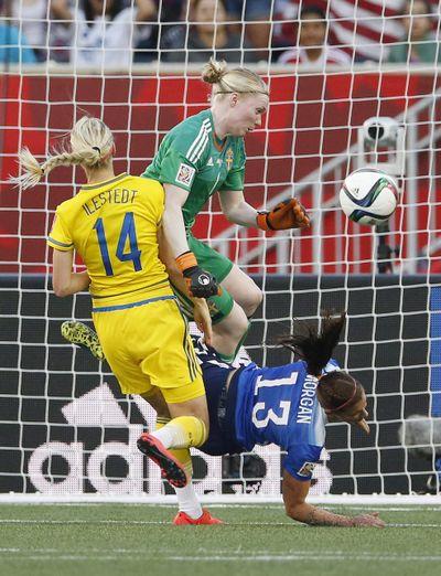 Sweden goaltender Hedvig Lindahl saves header from Alex Morgan (13). Amanda Ilestedt defends. (Associated Press)