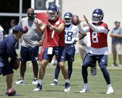 Tennessee Titans quarterbacks Marcus Mariota (8) and Blaine Gabbert (7) take a snap during an organized team activity at the Titans' NFL football training facility Tuesday, June 5, 2018, in Nashville, Tenn. Titans offensive coordinator Matt LaFleur wants to make sure Mariota is as comfortable with Tennessee's new offense as possible, planning to call plays that fit his quarterback best. (Mark Humphrey / Associated Press)