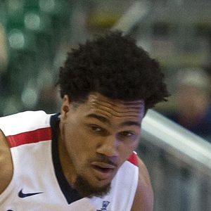 Gonzaga guard Silas Melson (0) dribbles the ball around Portland guard Alec Wintering (2) during the second half in Saturday's WCC tournament game. (Colin Mulvany / The Spokesman-Review)
